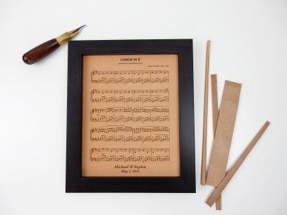 Leather sheet music handmade and engraved by Jessica Wilkeson