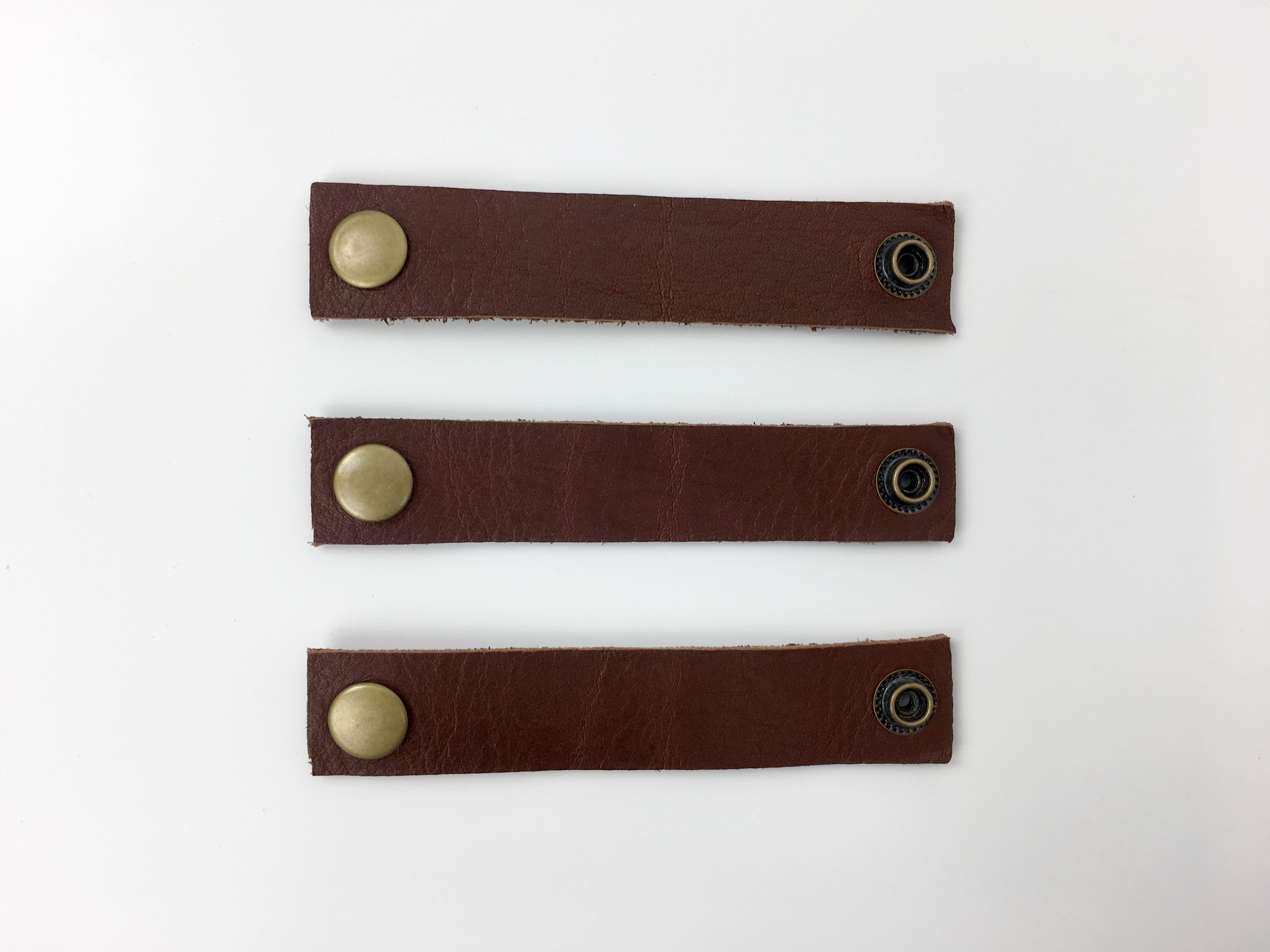 set of 3 leather cord keepers