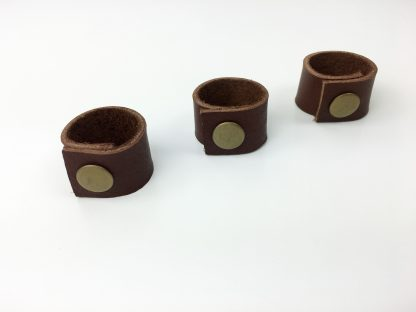 leather cord holders with brass snaps