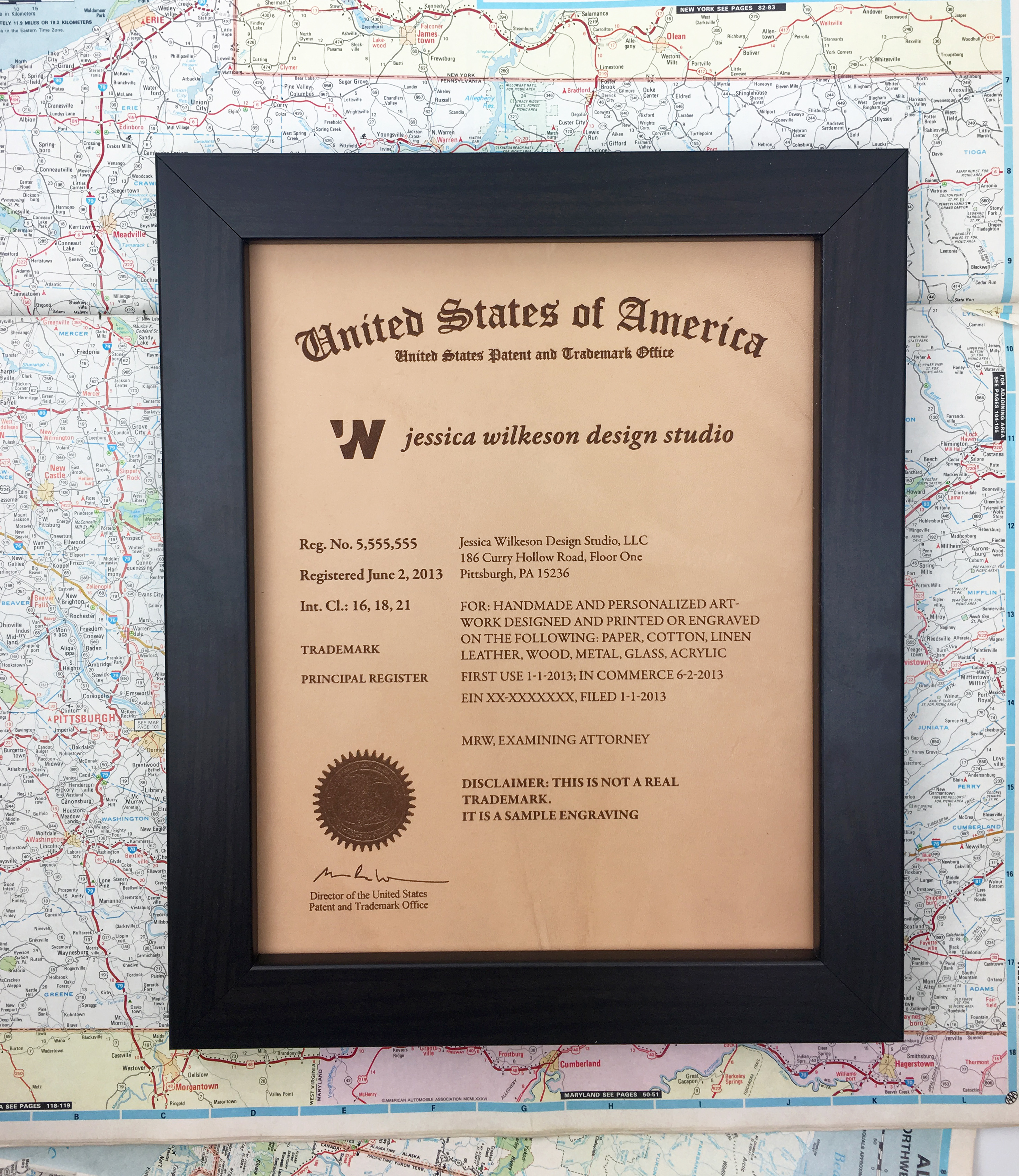 United States Trademark Registration plaque on leather